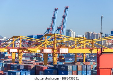 Vladivostok, Russia - 02, January, 2020: Container terminal of the commercial port in the Golden Horn Bay. The terminal station of the Trans-Siberian Railway.
