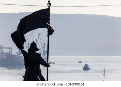 Vladivostok, Russia, 2017: Merchant and warships on the roadstead in the Golden Horn Bay in Vladivostok. Seaport Vladivostok
