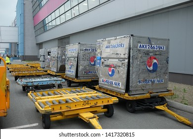 Vladivostok, Russia - 4 June 2019: Aircraft containers belonging to Korean Air waiting to be loaded into a freighter prime air plane to be transported to their destination.