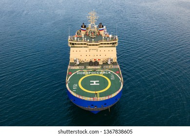 Vladivostok, Russia - April 9, 2019:Icebreaker Novorossiysk stands on the anchorage in the port of Vladivostok. Shooting from a quadcopter.