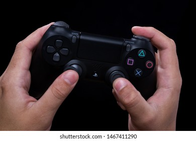 Vladivostok, Russia - August, 01, 2019: Hands holds game controller Dualshock 4 for Sony PlayStation 4