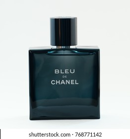 VLADIVOSTOK, RUSSIA - DECEMBER 4, 2017: A bottle of Bleu De Chanel perfume on a light background. Chanel S. A. - French company founded by fashion designer Coco Chanel in Paris.
