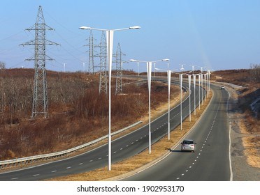 VLADIVOSTOK, RUSSIA - JANUARY 9: Electrified highway with divided oncoming lanes on Russky Island - on January 9, 2021 in Vladivostok