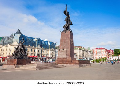 VLADIVOSTOK, RUSSIA - JULY 17, 2016: Memorial to the Fighters for the Soviet Power in the Far East and Dalrybvtuz building on central square in Vladivostok, Primorsky Krai in Russia
