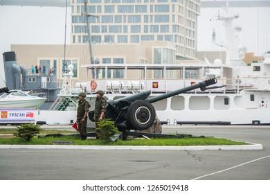 Vladivostok, Russia - July 27, 2018: 122-mm howitzer with combat crew on the sea mooring.