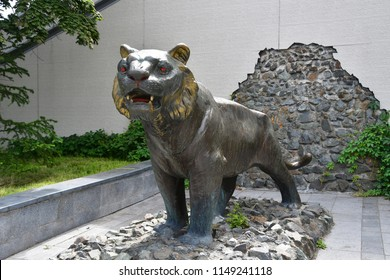 Vladivostok, Russia, July, 29,2018. Bronze sculpture of Amur tiger in Vladivostok in summer