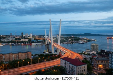 Vladivostok, Russia - June 24 2018:  Night panorama cityscape. ​​View on the Golden Bridge and Golden Horn Bay