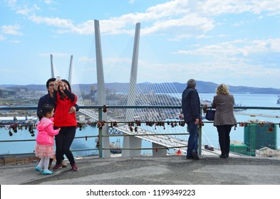 "Vladivostok, Russia, May, 07, 2016. Tourists on the observation deck ""Eagle's nest"" in Vladivostok in the spring"