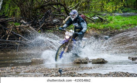 "Vladivostok, Russia - may 1, 2014: off- road cars, motorcycles, Enduro and ATV, go off-roading in five-day race ""Russian rally 2014"""