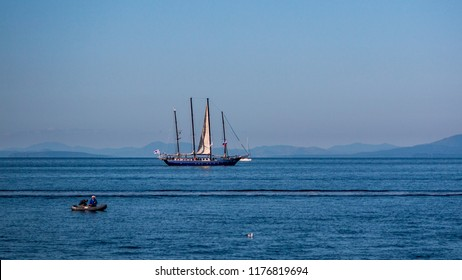 VLADIVOSTOK, RUSSIA - SEPTEMBER 11, 2018: The movement of ships in the Amur Bay of the Bosporus Vostochny strait in the background of the Russian Island during the preparation for the sailing regatta.