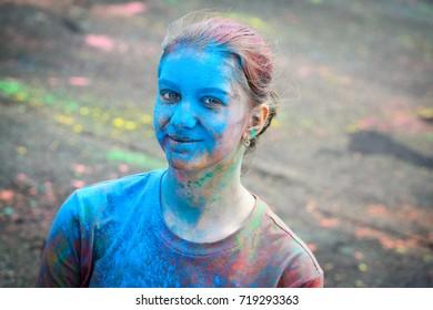 Vladivostok, Russia - September 17, 2017: The smiling girl at a festival of colours Holi.