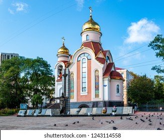 VLADIVOSTOK, RUSSIA - SEPTEMBER 22, 2018: The Church of St. Prince-Martyr of Igor of Chernigov in Vladivostok is near a monument to the soldiers of the rule of law