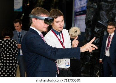 VLADIVOSTOK, RUSSIA - SEPTEMBER 6, 2017: East Economic Forum 2017 - EEF2017. Sergei Ivanov - president of Alrosa inspecting VR stand