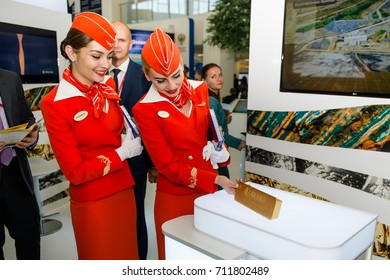 VLADIVOSTOK, RUSSIA - SEPTEMBER 6, 2017: East Economic Forum 2017 - EEF2017. 12.6kg golden bar at EEF and Aeroflot girls
