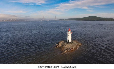 Vladivostok, Russia-August 26, 2018: Seascape with a view of the lighthouse against the sea.