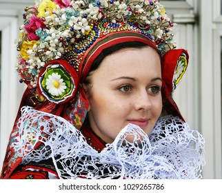 VLCNOV, CZECH REPUBLIC - MAY 27, 2007: Girl in folk costume during celebration Ride of the kings of Vlcnov. Celebration is on UNESCO list of Intangible Cultural Heritage of Humanity.