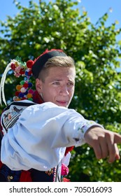 Vlcnov, Czech Republic - May 28, 2017: 18 years boy, who plays King's courtier, point to spectator in crowd during the parade. This sign means, that spectator should donate money for King's entourage