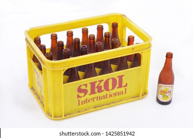 VLEDDER, THE NETHERLANDS - MARCH 15, 2014: An old beer crate with empty bottles of Skol International. Skol is a not so successful beer brand that disappeared from the Dutch market in the 1980s.