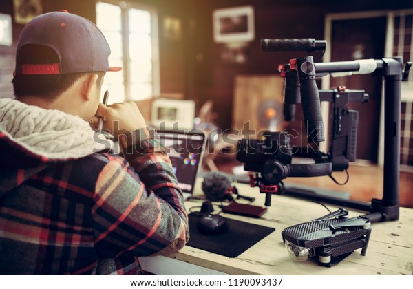 Vlogger editing video create content for upload on social media or internet online connect communication people ware.