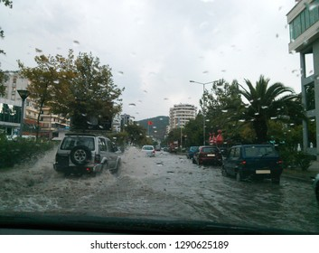 Vlora, Albania - August 10 2013: Cars driving through water after a flash flood