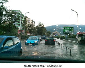 Vlora, Albania - August 10 2013: Cars driving through a flooded street after a summer flash flood