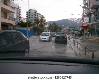 Vlora, Albania - August 10 2013: Traffic moving along flooded street after a flash flood
