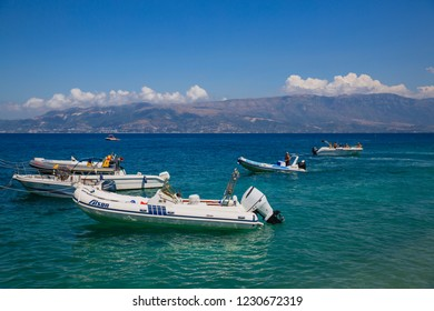VLORA, ALBANIA - JULY 17, 2017: Many boats on the sea at sunny day on Adriatic coast with a clear blue sea