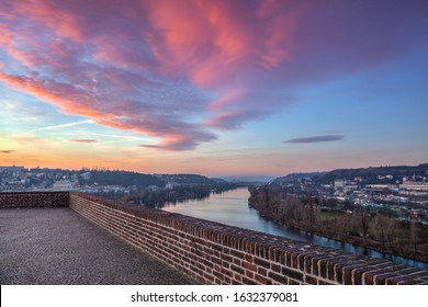 Vltava River in Prague, Czech Republic, viewed from the Vysehrad fort in the pink sunrise. Vysehrad is a historic fort located in the city of Prague. It was built probably in the 10th century.