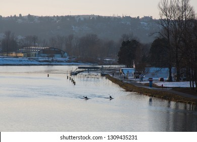 vltava river at sunset with rowers
