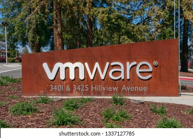 VMware logo and company name on entrance to campus headquarters in Silicon Valley. VMware is a subsidiary of Dell Technologies - Palo Alto, California, USA - March 12, 2019