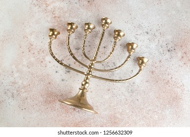 Vntage brass candelabrum for seven candles on concrete background. Copy space for text.