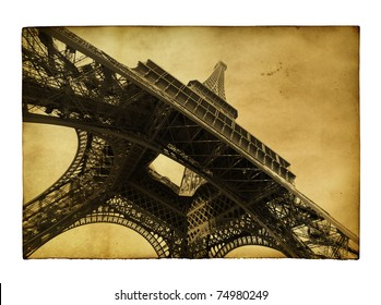 Vntage postcard with Eiffel tower isolated over white background