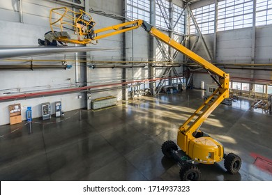 VNUKOVO, July 02, 2018 : A boom lift taking a worker to the plane tail. Aircraft maintenance service