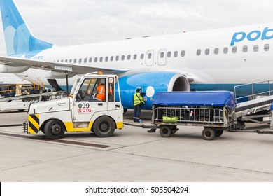 VNUKOVO, MOSCOW REGION, RUSSIA - 28 April 2016: Airplanes at Vnukovo international airport. Pobeda Airlines Boeing 737 loading and unloading of luggage
