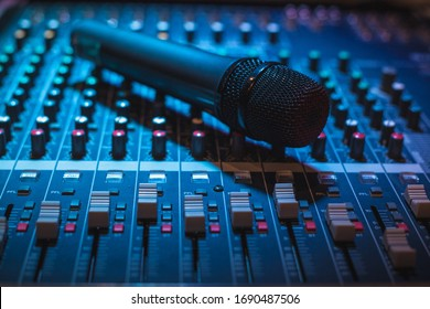 Vocal microphone and sound table or audio mixer, professional sound equipment for live musicians, singers, sound technicians and music producers.