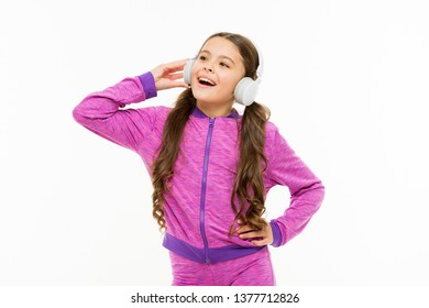 Vocal music lover. Athletic kid training her vocal after workout. Small child doing vocal on song. Little girl listening and singing vocal melody.