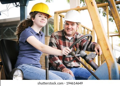Vocational instructor teaching a young construction apprentice how to drive heavy equipment.