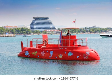 VODICE, CROATIA - AUGUST 09, 2018: Red Semi-submarine with glass bottom so tourists can see the marine life, Vodice, on August 09, 2018 in Croatia