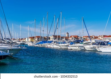 VODICE, CROATIA- FEBRUARY 24, 2018: View of a picturesque dalmatian village with a marina with moored boats and yachts on a sunny day, Vodice, Croatia