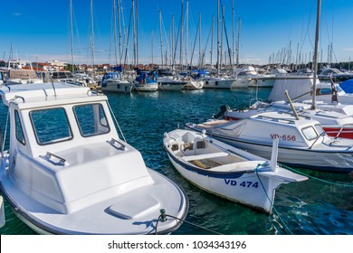 VODICE, CROATIA- FEBRUARY 24, 2018: Seascape view of typical dalmatian fishing boats and sailing yachts moored in the marina on a sunny day, Vodice in Croatia.