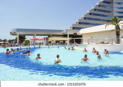 Vodice, Croatia - July 10, 2018: Vacationers near pool of Olympia Sky Hotel.