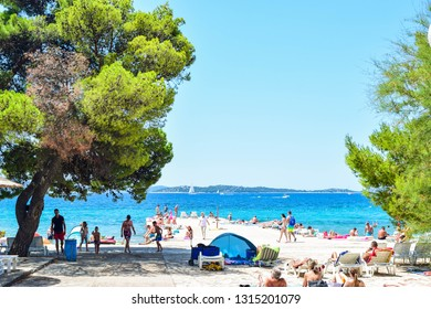 Vodice, Croatia - July 10, 2018: Vacationers on the beautiful  beach.