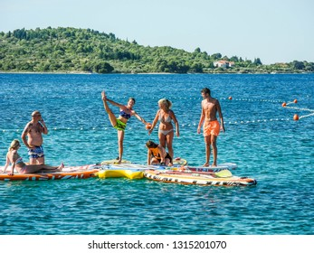 Vodice, Croatia - July 9, 2018: Group at aqua yoga classes.