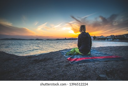 Vodice, Croatia - May 4 2019: A women enjoying the setting sun scenery of Vodice coastal town.