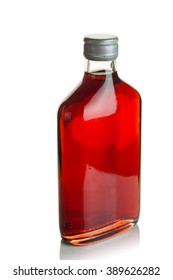 Vodka infused with cranberries in a flat glass bottle on a white background.