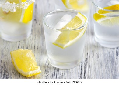 vodka and lemon. Vodka with ice. Selective focus.