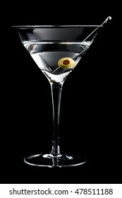 Vodka martin cocktail with olives on black background