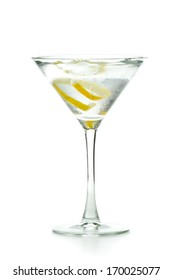 vodka martini garnished with a lemon twist isolated on a white background