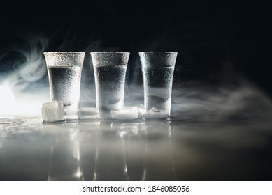 Vodka. Shots, glasses with vodka with ice .Dark background. Copy space .Selective focus