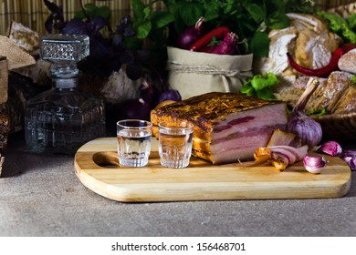 Vodka and smoked meat on a table